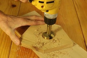 Drill the entrance hole for the bird house